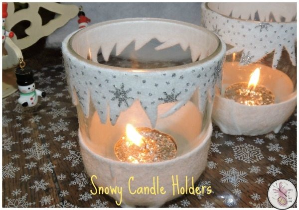 snowy-candle-holders